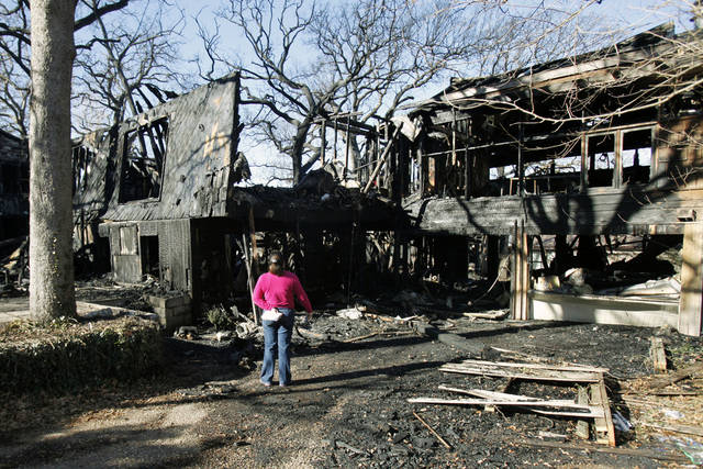 An insurance adjuster surveys the damage to a house which was destroyed in an early morning fire at 5709 NW 32nd in Oklahoma City, OK, Tuesday, Jan. 3, 2012. By Paul Hellstern, The Oklahoman