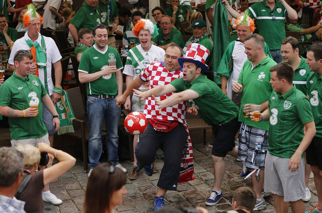 Republic of Ireland fans play football with Croatia fans during the Euro 2012 soccer championship in Poznan, Poland, Sunday, June 10, 2012. (AP Photo/Peter Morrison)