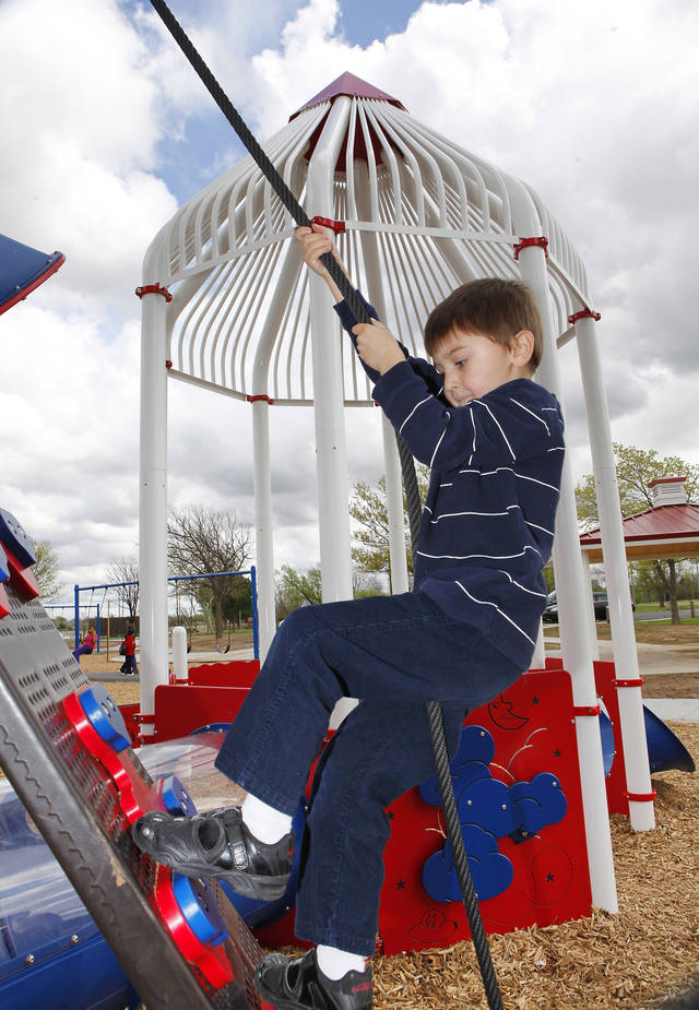 Conan Novotny, 5, climbs on the new playground at Stars and Strips park on Lake Hefner. Art for story on Oklahoma City parks long-term plan story, Tuesday, March 19, 2012.  Photo By David McDaniel/The Oklahoman