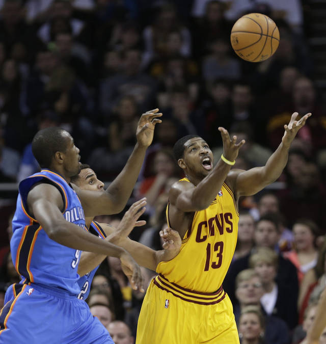 Cleveland Cavaliers' Tristan Thompson, right, tries to grab a rebound ahead of Oklahoma City Thunder's Serge Ibaka, left, from the Republic of Congo, during the first quarter of an NBA basketball game on Saturday, Feb. 2, 2013, in Cleveland. (AP Photo/Tony Dejak) ORG XMIT: OHTD103