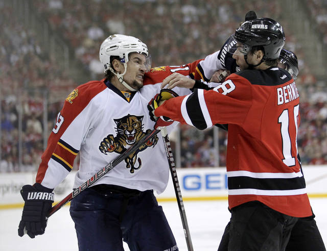 Florida Panthers' Scottie Upshall, left, and New Jersey Devils' Steve Bernier fight during the first period of Game 3 of a first-round NHL hockey Stanley Cup playoff series, Tuesday, April 17, 2012, in Newark, N.J. (AP Photo/Julio Cortez)