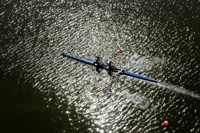 The USA team of Tom Paradiso and Robert Duff head toward the starting line of their race during the USA Rowing World Challenge on the Oklahoma River in Oklahoma City, OK, Friday, Sept. 30, 2011. By Paul Hellstern, The Oklahoman