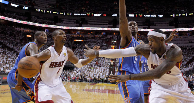 Miami's LeBron James (6) passes the ball past Oklahoma City's Serge Ibaka (9) and Kevin Durant (35) as Chris Bosh (1) watches during Game 4 of the NBA Finals between the Oklahoma City Thunder and the Miami Heat at American Airlines Arena, Tuesday, June 19, 2012. Photo by Bryan Terry, The Oklahoman