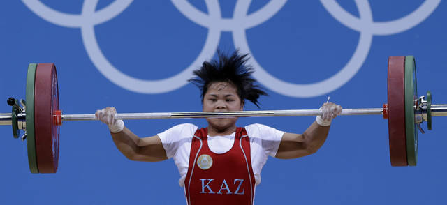 Kazakhstan's Zulfiya Chinshanlo lifts during the women's 53-kg, group A, weightlifting competition at the 2012 Summer Olympics, Sunday, July 29, 2012, in London. (AP Photo/Hassan Ammar)