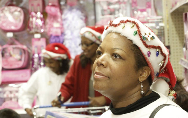Lisa Carr shops at Toys R Us in Oklahoma City, Friday November, 25,  2011. Oklahoman Photo by Steve Gooch