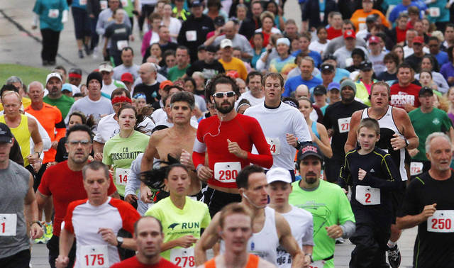 Nearly 300 people participated in the run. The Renaissance Run, a  5K run and walk begins at 8:30 a.m. at the Midwest City Community Center. Following the race, runners are invited to enjoy a pancake breakfast  at Midwest Regional Medical Center, 2825 Parklawn Drive on Saturday, Sep. 15, 2012,  Photo by Jim Beckel, The Oklahoman.