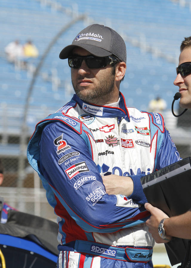 Elliott Sadler waits to drive during qualifying for the NASCAR Nationwide Series auto race, Saturday, Nov. 17, 2012 at the Homestead-Miami Speedway in Homestead, Fla. (AP Photo/David Graham)