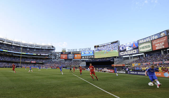 Chelsea FC's Kevin de Bruyne, right, puts a shot on-goal during the first half of an exhibition soccer match against Paris Saint-Germain at Yankee Stadium in New York, Sunday, July 22, 2012. (AP Photo/Henny Ray Abrams)