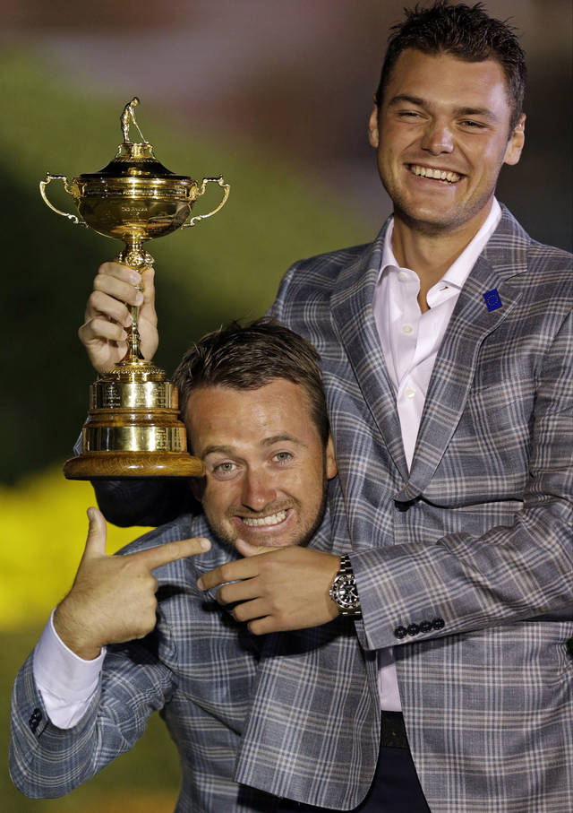 Europe's Graeme McDowell and Martin Kaymer celebrate after the Ryder Cup PGA golf tournament Sunday, Sept. 30, 2012, at the Medinah Country Club in Medinah, Ill. (AP Photo/David J. Phillip)  ORG XMIT: PGA270