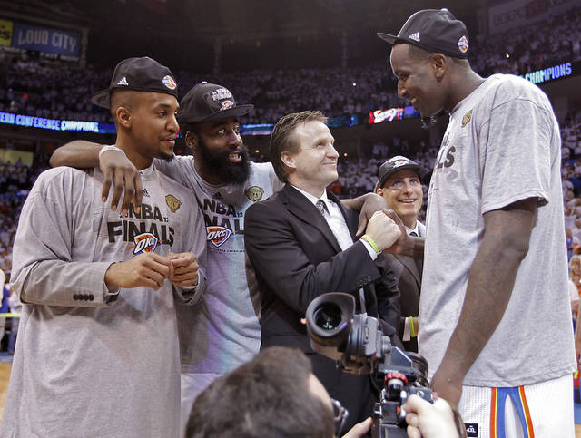 Eric Maynor, James Harden, Scott Brooks and Kendrick Perkins, from left, celebrate after the 107-99 win over the Spurs during Game 6 of the Western Conference Finals between the Oklahoma City Thunder and the San Antonio Spurs in the NBA playoffs at the Chesapeake Energy Arena in Oklahoma City, Wednesday, June 6, 2012. Photo by Chris Landsberger, The Oklahoman