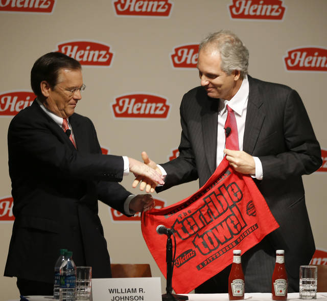 H.J. Heinz Co. CEO William Johnson, left, and 3G Capital Managing Partner Alex Behring shake hands after a news conference at the world headquarters of the H.J. Heinz Co. on Thursday, Feb. 14, 2013, in Pittsburgh. Billionaire investor Warren Buffett�s Berkshire Hathaway and its partner on the deal. 3G Capital, are dipping into the ketchup business as part of a $23.3 billion deal to buy the Heinz ketchup company. (AP Photo/Keith Srakocic)