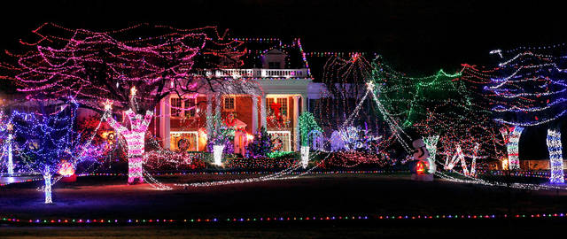 An eye-catching, car-stopping lighting display illuminates yards of three neighboring houses on Grand Boulevard in Nichols Hills .  December 18, 2011.     Photo by Jim Beckel, The Oklahoman