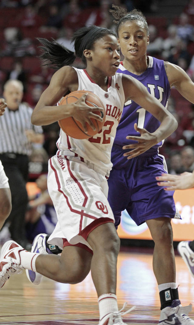 Oklahoma Sooners' DaShawn Harden (22) drives to the basket in the second half as the University of Oklahoma (OU) Sooners defeated the Texas Christian University (TCU) Horned Frogs 82-54 in women's college basketball at the Lloyd Noble Center on Wednesday, Dec. 28, 2011, in Norman, Okla.  