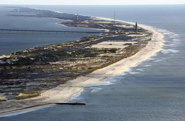 FILE - This Friday, Jan. 18 2013 aerial file photo shows Robert Moses State Park on Fire island, N.Y., after superstorm Sandy struck Oct. 29, 2012, damaging many oceanfront communities. On Friday, May 10, 2013, officials on Fire Island were to discuss plans for the summer season six months after being slammed by  Sandy.(AP Photo/Mark Lennihan, File)