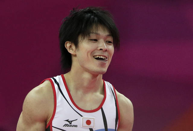 Japanese gymnast Kohei Uchimura celebrates after being declared winner of the gold medal during the artistic gymnastics men's individual all-around competition at the 2012 Summer Olympics, Wednesday, Aug. 1, 2012, in London. (AP Photo/Gregory Bull)