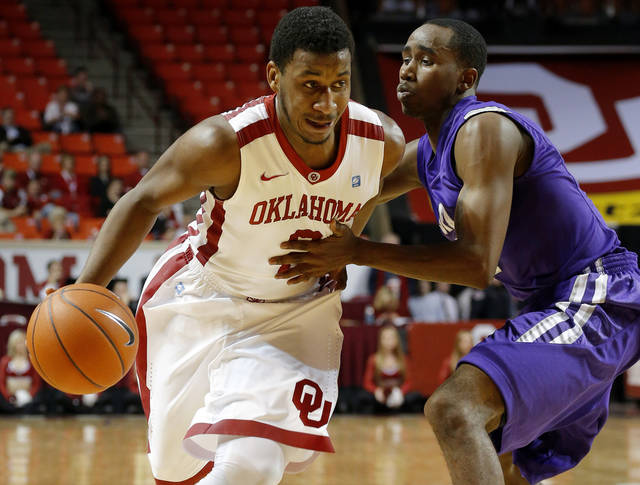 Oklahoma's Steven Pledger (2) tries to get past Stephen F. Austin's Antonio Bostic (5) during a  college basketball game between the University of Oklahoma (OU) and Stephen F. Austin University at the Lloyd Noble Center in Norman, Okla., Tuesday, Dec. 18, 2012. Photo by Bryan Terry, The Oklahoman