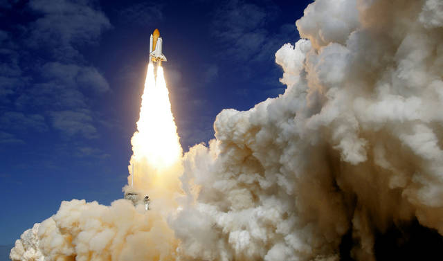 The space shuttle Atlantis lifts off Monday from Kennedy Space Center's Launch Pad 39-A in Cape Canaveral, Fla. Six astronauts are headed to the International Space Station on an 11-day mission. AP PHOTO