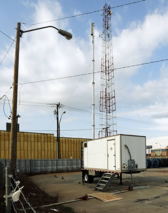 A mobile AT&T cell tower sits in a parking lot on the southeast corner of 4th and Broadway before Game 5 in the first round of the NBA playoffs between the Oklahoma City Thunder and the Houston Rockets at Chesapeake Energy Arena in Oklahoma City, Wednesday, May 1, 2013. Photo by Nate Billings, The Oklahoman