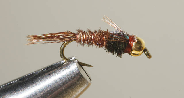 A Gold Bead Pheasant fly for fly fishing at Backwoods in Oklahoma City Thursday, Jan. 17, 2013.  Photo by Paul B. Southerland, The Oklahoman
