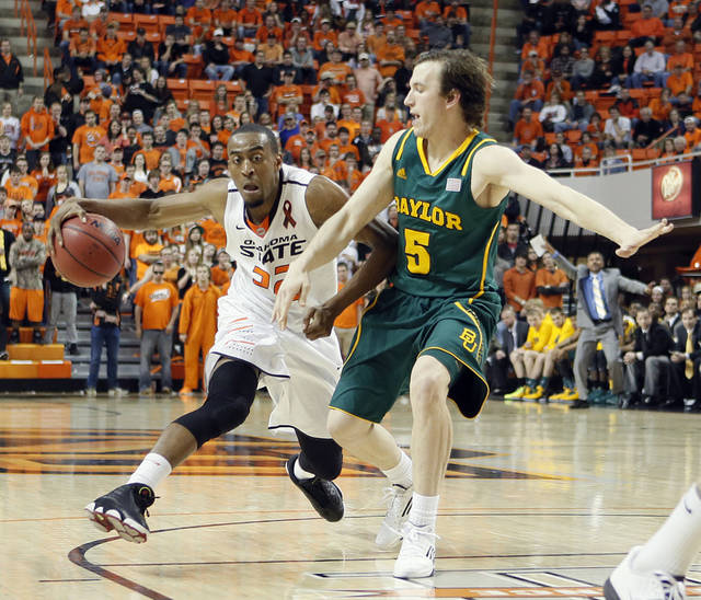 Oklahoma State 's Markel Brown (22) drives against Baylor's Brady Heslip (5) during the college basketball game between the Oklahoma State University Cowboys (OSU) and the Baylor University Bears (BU) at Gallagher-Iba Arena on Wednesday, Feb. 5, 2013, in Stillwater, Okla. Photo by Chris Landsberger, The Oklahoman