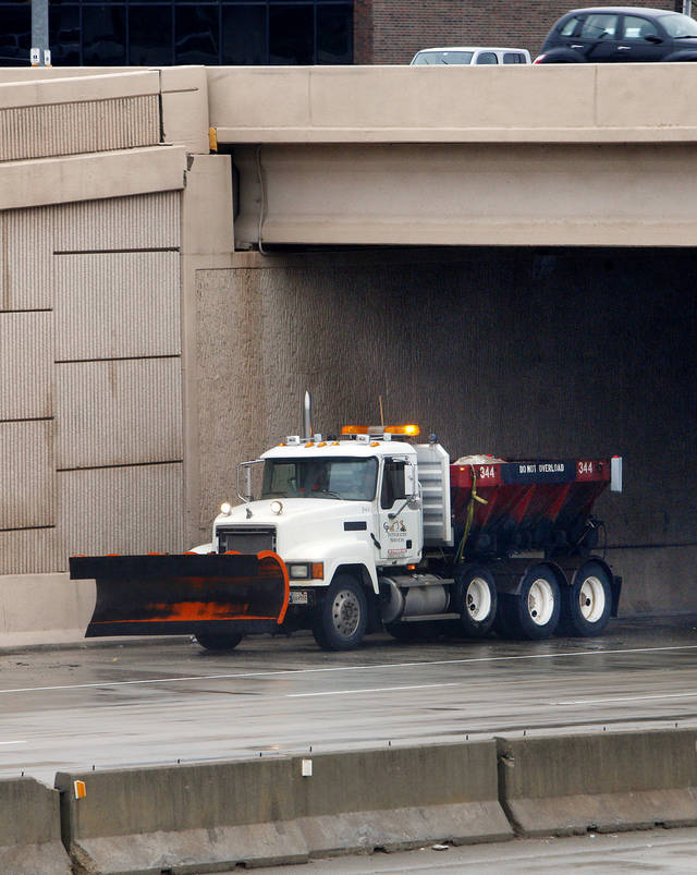A snow plow stages underneath the 63 Street bridge on the Broadway Extension while waiting for the weather to worsen in Oklahoma City Monday, Feb. 25, 2013. Photo by Paul B. Southerland, The Oklahoman