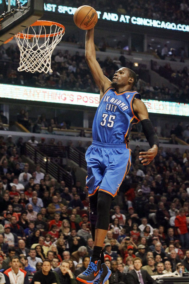 Oklahoma City Thunder small forward Kevin Durant scores on a breakaway during the first half of an NBA basketball game against the Chicago Bulls, Thursday, Nov. 8, 2012, in Chicago. (AP Photo/Charlie Arbogast) ORG XMIT: CXA102