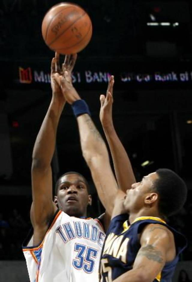 Oklahoma City&#039;s  Kevin  Durant takes a shot over Indiana&#039;s Brandon Rush during the NBA basketball game between the Indiana Pacers and the Oklahoma City Thunder at the Ford Center in Oklahoma City, Sunday, April 5, 2009. Photo by John Clanton