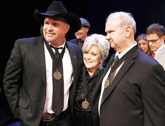 Garth Brooks, left, Connie Smith, center, and Hargus �Pig� Robbins attend the Country Music Hall of Fame Inductions on Sunday in Nashville, Tenn. AP Photo