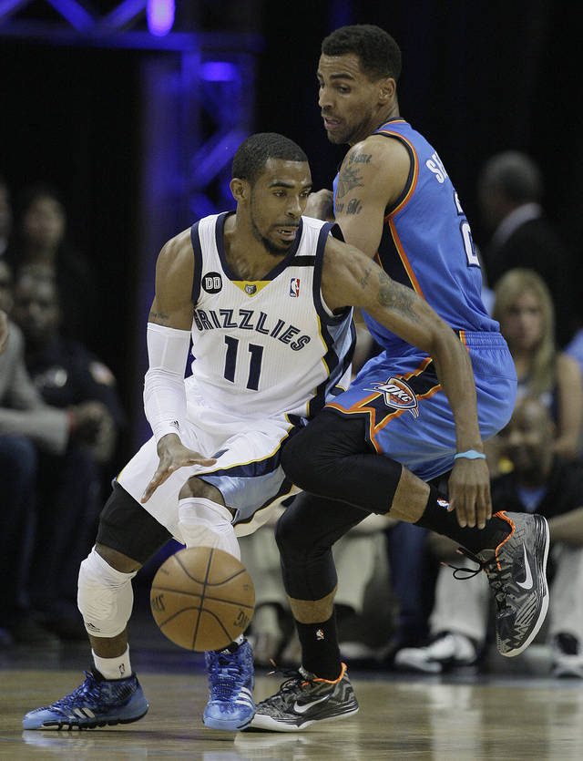 Oklahoma City Thunder's Thabo Sefolosha, of Switzerland, right, defends against Memphis Grizzlies point guard Mike Conley (11) in the first half of Game 4 in a Western Conference semifinal NBA basketball playoff series in Memphis, Tenn., Monday, May 13, 2013. (AP Photo/Danny Johnston)