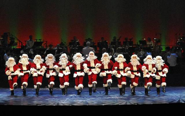 A line of Santas dance in the Oklahoma City Philharmonic�s �The Christmas Show.� Photo by Wendy Mutz