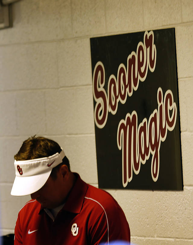 Bob Stoops goes over the pre-game plan during the college football game between the University of Oklahoma Sooners (OU) and the University of Texas El Paso Miners (UTEP) at Sun Bowl Stadium on Saturday, Sept. 1, 2012, in El Paso, Tex.  Photo by Chris Landsberger, The Oklahoman