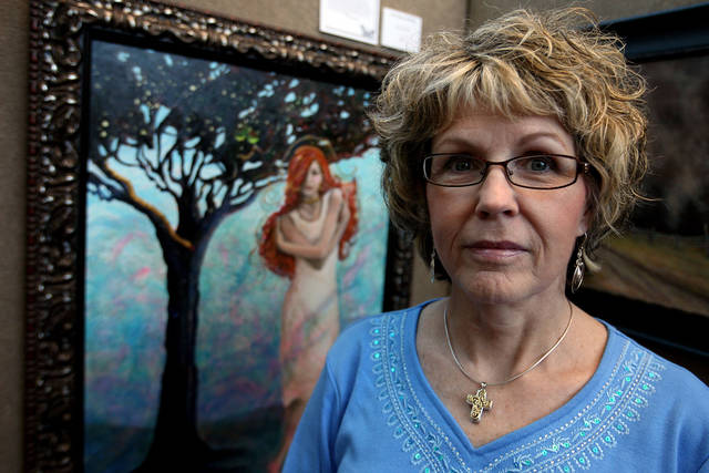 "Mary Lou Moad poses for a portrait with her painting ""It all Began with Eve"" at Integris Cancer Institute of Oklahoma in Oklahoma City Tuesday, June 22, 2010.  Photo by Miranda Grubbs, The Oklahoman"