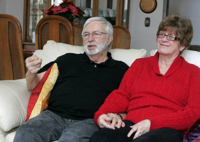 In this Feb. 25, 2013 photo, Gary Robb and his wife, Fran, sit in their Rockford, Ill., home and talk about the heart transplant Gary received in April 2009. Robb, 72, received the transplant at UW Hospital in Madison, Wis., after suffering for years with congestive heart failure. The donor was 16-year-old Andrew Duerkop, of Madison, who died after being hit by a car while riding his bicycle. (AP Photo/Rockford Register Star, Amy J. Correnti)  MANDATORY CREDIT