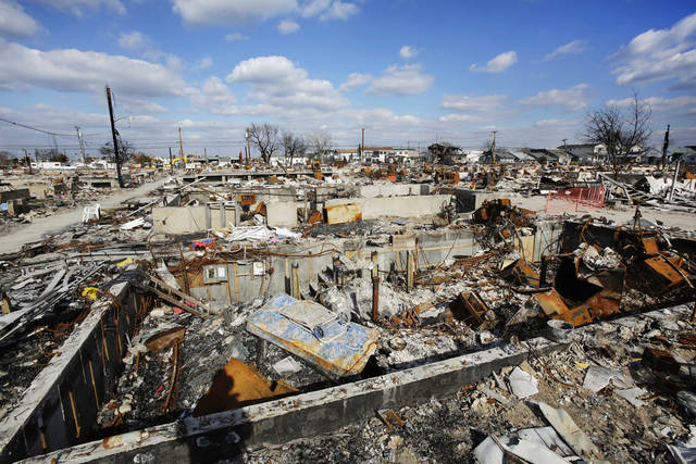 The wreckage of homes burned at Breezy Point during Superstorm Sandy is shown, Monday, Feb. 4, 2013 in the Queens borough of New York, More than 100 homes burned to the ground in a firestorm the night of Oct. 29, 2012. (AP Photo/Mark Lennihan)