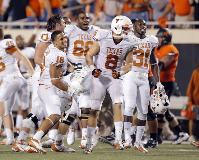 Texas celebrates their win over Oklahoma State following a college football game between Oklahoma State University (OSU) and the University of Texas (UT) at Boone Pickens Stadium in Stillwater, Okla., Saturday, Sept. 29, 2012. Texas on 41-36. Photo by Sarah Phipps, The Oklahoman