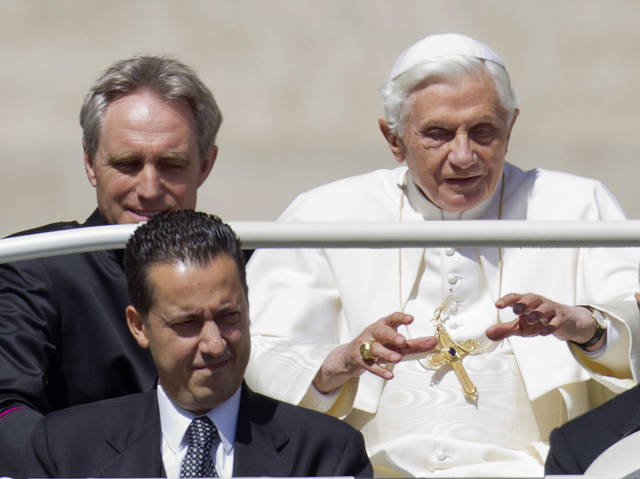   FILE -- In this photo taken Wednesday, May, 23, 2012, Pope Benedict XVI, flanked by his private secretary Georg Gaenswein, top left, and his butler Paolo Gabiele arrives at St. Peter&#039;s square at the Vatican for a general audience. A verdict in the case of the pope&#039;s butler accused of leaking papal documents may help close one of the most damaging scandals of Pope Benedict XVI&#039;s papacy. But even after Paolo Gabriele&#039;s fate is decided by a Vatican tribunal Saturday, Oct. 6, 2012 a core question will remain open: Did he really act alone in exposing the secrets of one of the most secretive institutions in the world? (AP Photo/Andrew Medichini, File)  