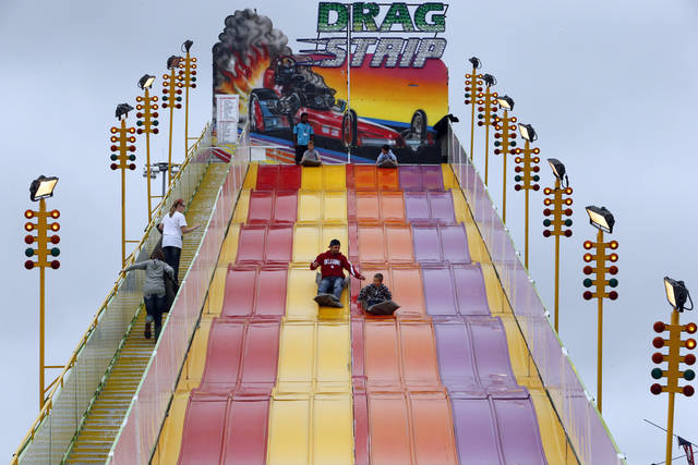 Fairgoers ride the giant Drag Strip slide at the 106th Oklahoma State Fair at State Fair Park on Saturday, Sept. 15, 2012, in Oklahoma City, Okla.  Photo by Steve Sisney, The Oklahoman