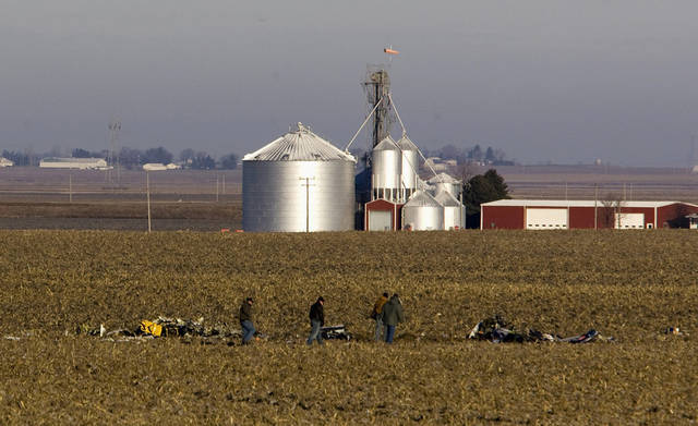 Emergency personnel investigate the scene of a medical helicopter crash Tuesday, Dec. 11, 2012, near Rochelle, Ill., about 70 miles west of Chicago. Rockford Memorial Hospital officials say the pilot and two nurses were killed in the Monday night crash while traveling between two northern Illinois hospitals. No patients were aboard the helicopter that was flying to pick up a patient at a Mendota hospital. (AP Photo/Rockford Register Star, Scott Morgan)  MANDATORY CREDIT