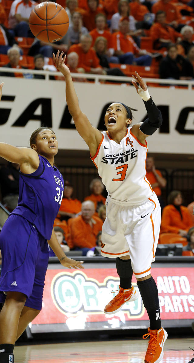 Oklahoma State's Tiffany Bias (3) goes to the basket past Stephen F. Austin's Tierany Henderson (31) during a women's college basketball game between Oklahoma State University and Stephen F. Austin at Gallagher-Iba Arena in Stillwater, Okla., Thursday, Dec. 6, 2012.  Photo by Bryan Terry, The Oklahoman