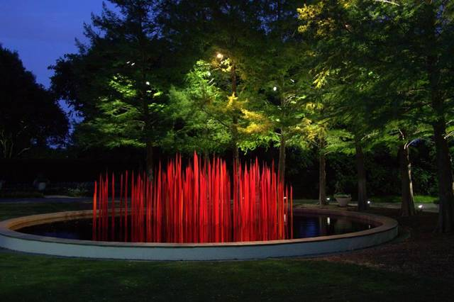 """Reed Reeds,"" an installation of Dale Chihuly glass art at the Dallas Arboretum, is illuminated for the arboretum's ""Chihuly Nights."" Photo provided."