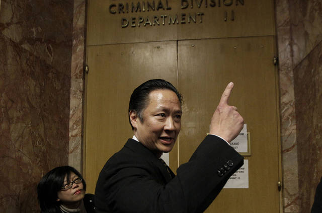 San Francisco Public Defender Jeff Adachi enters a courtroom at the Hall of Justice before the arraignment of Binh Thai Luc in San Francisco, Wednesday, March 28, 2012. Luc, 35, was charged with five counts of murder with special circumstances of committing multiple murders, robbery and burglary, according to court documents. (AP Photo/Jeff Chiu)