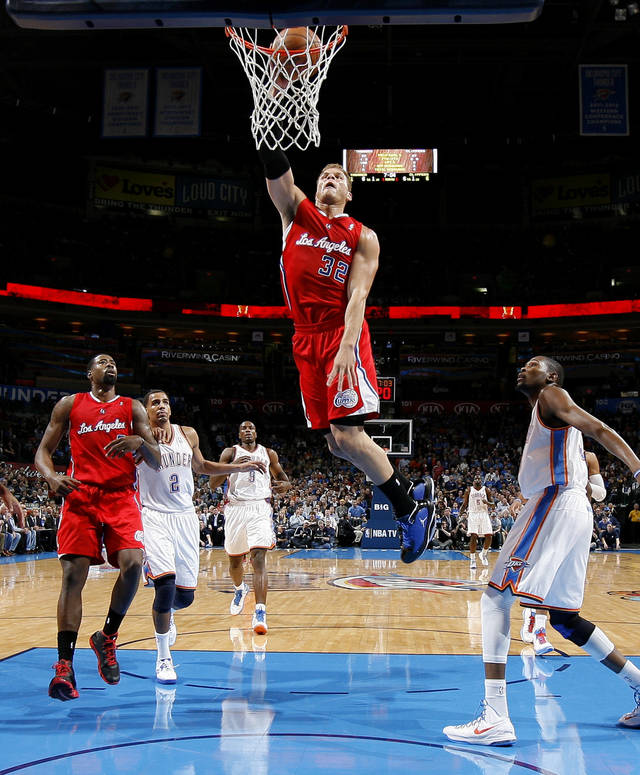 The Clippers Blake Griffin (32) dunks the ball as Oklahoma City's Kevin Durant (35) and Thabo Sefolosha (2) watch during an NBA basketball game between the Oklahoma City Thunder and the Los Angeles Clippers at Chesapeake Energy Arena in Oklahoma City, Wednesday, Nov. 21, 2012. Photo by Bryan Terry, The Oklahoman