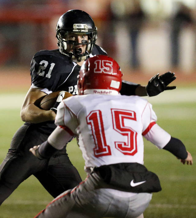 Brady Krittenbrink (21) of Pond Creek-Hunter tries to get past Taylor Townsend (15) of Fox during a Class B semifinal high school football playoff game between Pond Creek-Hunter and Fox in Del City, Friday, Nov. 23, 2012. Photo by Nate Billings, The Oklahoman
