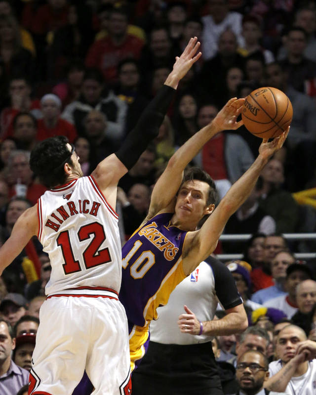 Chicago Bulls guard Kirk Hinrich (12) pressures Los Angeles Lakers guard Steve Nash during the second half of an NBA basketball game Monday, Jan. 21, 2013, in Chicago. The Bulls won 95-83. (AP Photo/Charles Rex Arbogast)