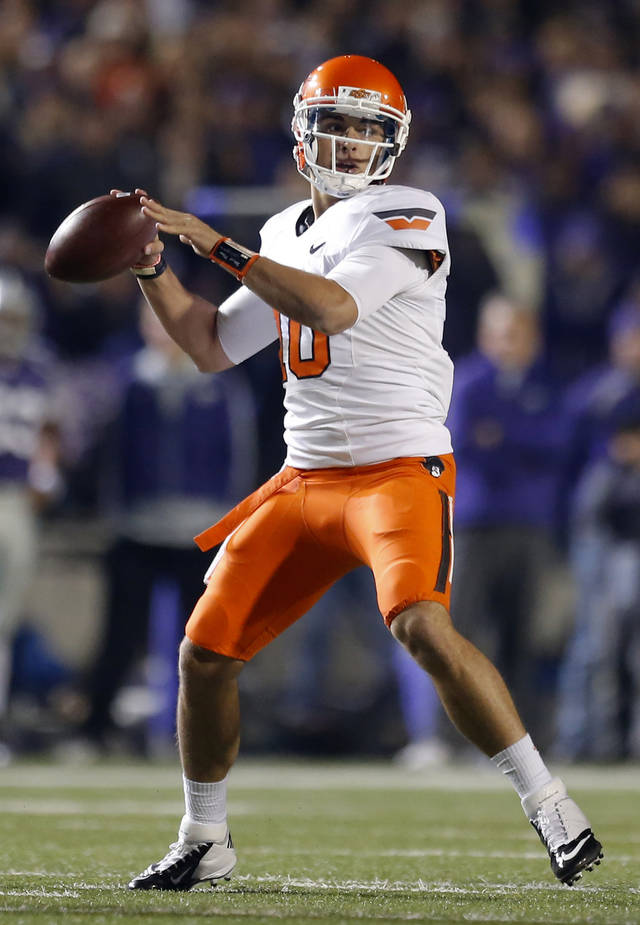 Oklahoma State&#039;s Clint Chelf (10) throws the ball during the college football game between Kansas State University (KSU) and Oklahoma State (OSU) at  Bill Snyder Family Football Stadium in Manhattan, Kan.,  Saturday, Nov. 3, 2012. Photo by Sarah Phipps, The Oklahoman