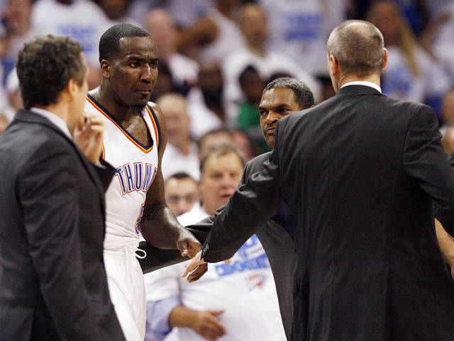 Oklahoma City's Kendrick Perkins (5) has words with Dallas head coach Rick Carlisle, right, as Thunder assistant coach Maurice Cheeks holds back Perkins during Game 2 of the first round in the NBA basketball  playoffs between the Oklahoma City Thunder and the Dallas Mavericks at Chesapeake Energy Arena in Oklahoma City, Monday, April 30, 2012. Photo by Nate Billings, The Oklahoman
