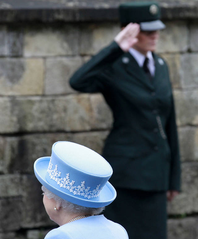 Britain's Queen Elizabeth II arrives for a Service of Thanksgiving in Saint Macartin's Cathedral in Enniskillen, Northern Ireland, Tuesday, June 26, 2012. The Queen arrived in Northern Ireland for a two day visit to mark the Queen's Diamond Jubilee. (AP Photo/Peter Morrison)