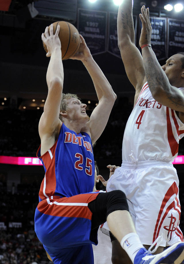 Detroit Pistons' Kyle Singler (25) goes up against Houston Rockets' Greg Smith (4) in the first half of an NBA basketball game Saturday, Nov. 10, 2012, in Houston. (AP Photo/Pat Sullivan)