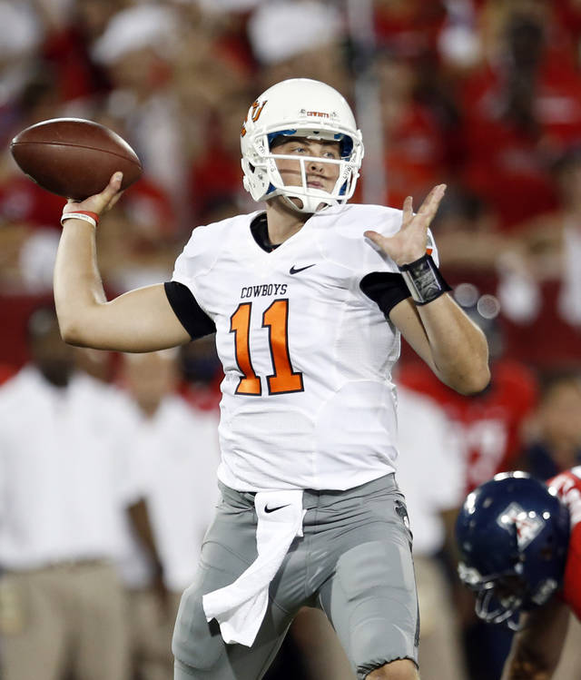 Oklahoma State's Wes Lunt (11) throws during the college football game between the University  of Arizona and Oklahoma State University at Arizona Stadium in Tucson, Ariz.,  Saturday, Sept. 8, 2012. Photo by Sarah Phipps, The Oklahoman