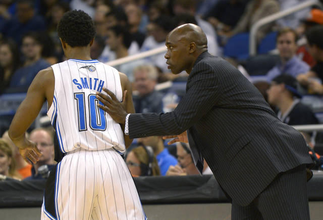 Orlando Magic head coach Jacque Vaughn, right, coaching his first career game, gives instructions to guard Ish Smith during the first half of an NBA basketball game against the Denver Nuggets in Orlando, Fla., Friday, Nov. 2, 2012. (AP Photo/Phelan M. Ebenhack)